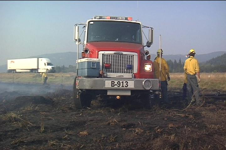 Firefighters held a field fire along Interstate 5 north of Beltline to 7 acres Wednesday evening. Thumbnail