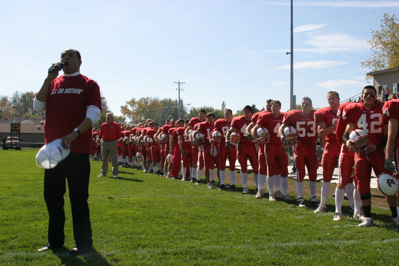 "Al Jarreau sings ""The Star-Spangled Banner"" before a Ripon College football game Oct. 7, 2006. (Photo courtesy Ripon College)"