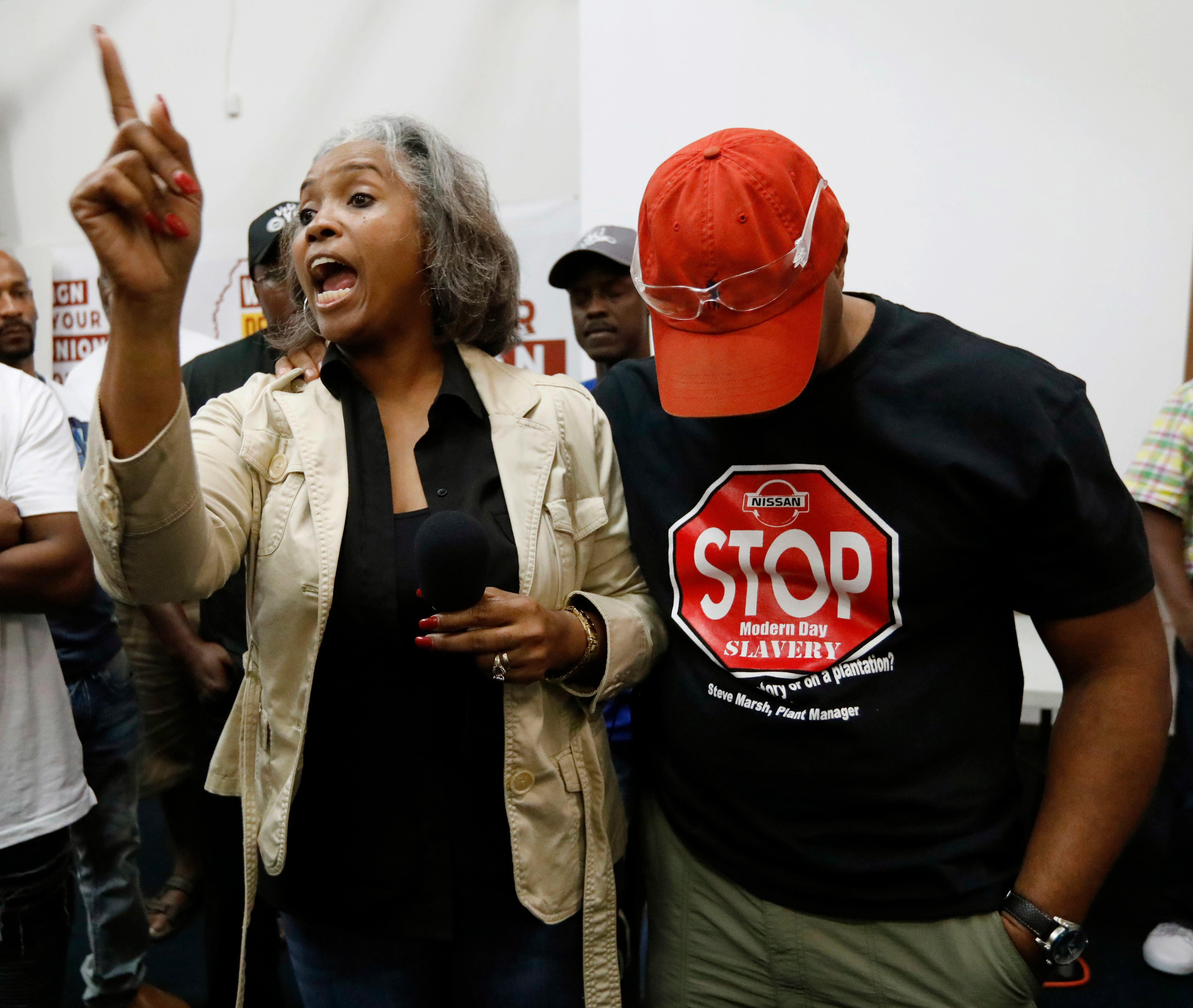 Nissan employee Betty Jones, left, consoles Morris Mock, right, while expressing her disappointment at losing their bid to form a union at the Nissan vehicle assembly plant in Canton, Miss., Friday, Aug. 4, 2017.  (AP Photo/Rogelio V. Solis)