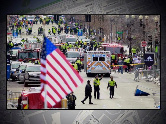 Emergency medical workers aid the injured following explosions at the finish line of the 2013 Boston Marathon.