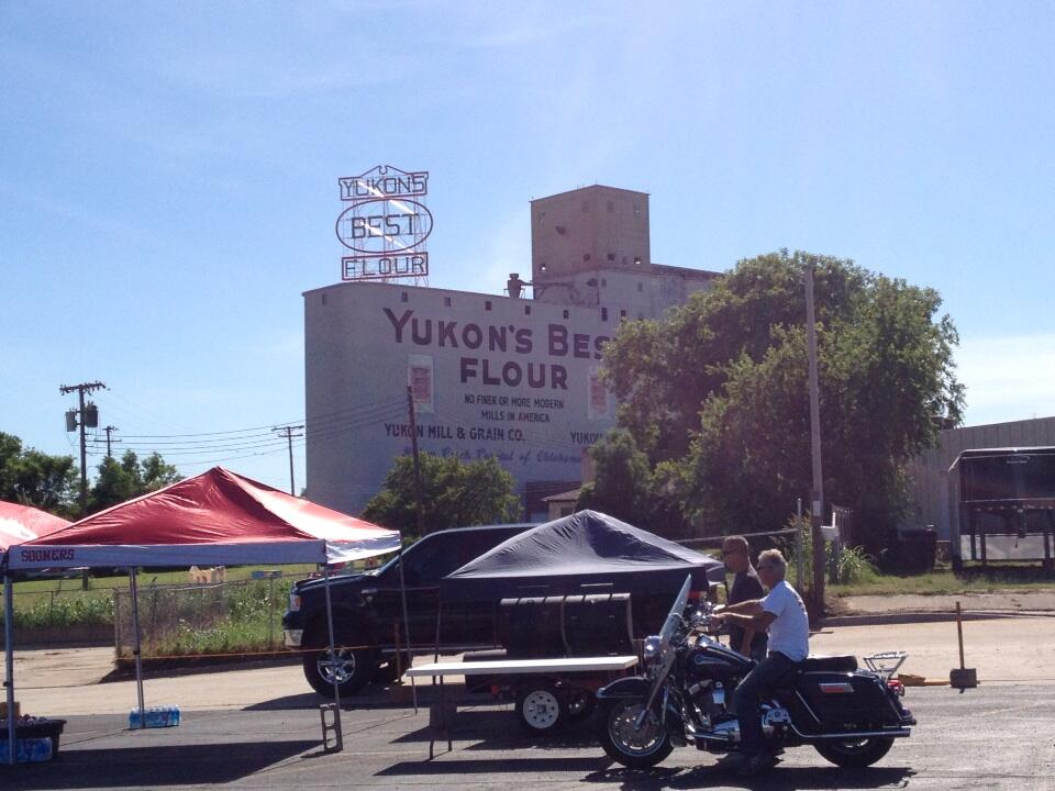 A crowd begins to gather for the re-lighting of the Yukon's Best Flour Mill sign.