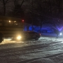 Car hits school bus on snowy roads in Kalamazoo