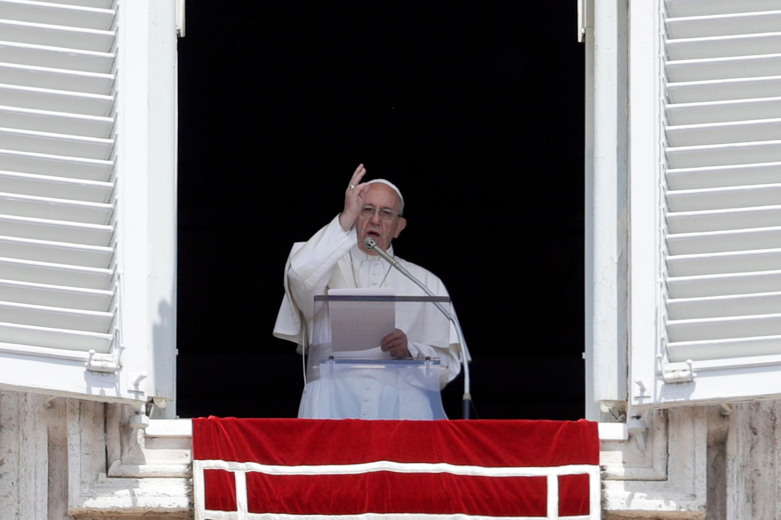 Pope Francis blesses faithful from his studio's window overlooking St. Peter's Square on the occasion of the Regina Coeli noon prayer at the Vatican, Sunday, May 14, 2017. (AP Photo/Gregorio Borgia)