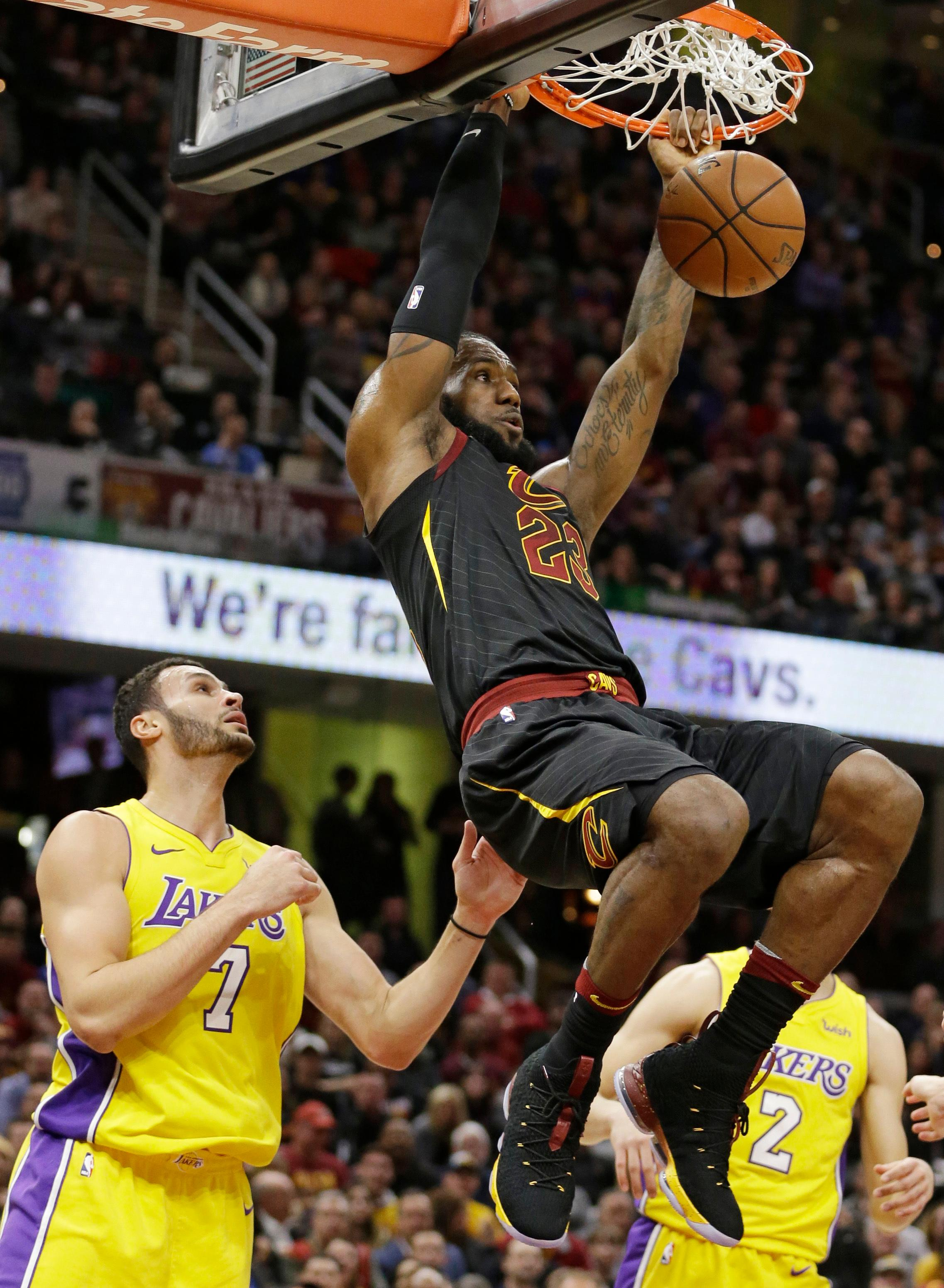 Cleveland Cavaliers' LeBron James (23) dunks against Los Angeles Lakers' Larry Nance Jr. (7) in the first half of an NBA basketball game, Thursday, Dec. 14, 2017, in Cleveland. (AP Photo/Tony Dejak)