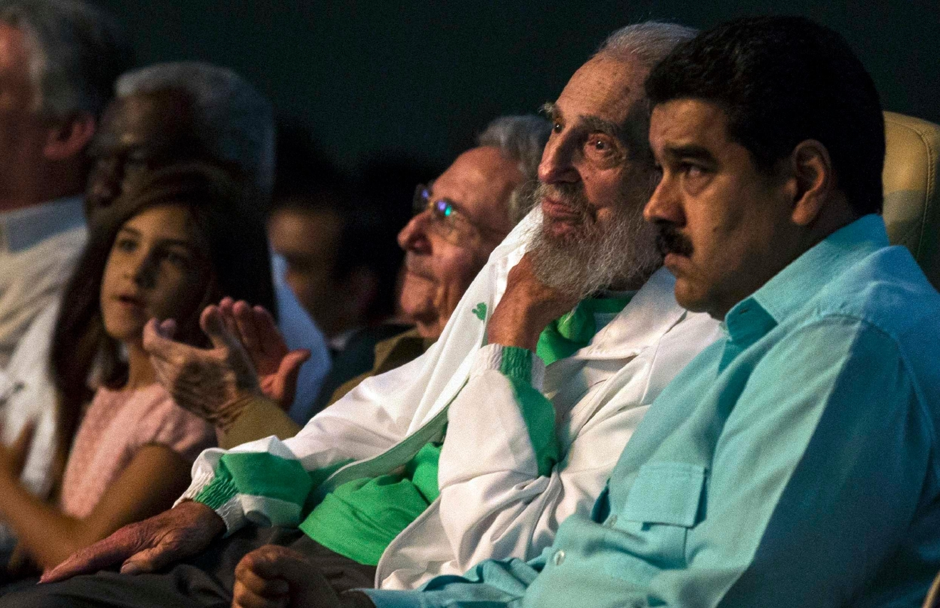 Cuba's former President Fidel Castro, center right, attends a gala for his 90th birthday accompanied by his brother and current President Raul, center left, and Venezuela's President Nicolas Maduro, right, at the 'Karl Marx' theater in Havana, Cuba, Saturday, Aug. 13, 2016. (Ismael Francisco, Cubadebate via AP)