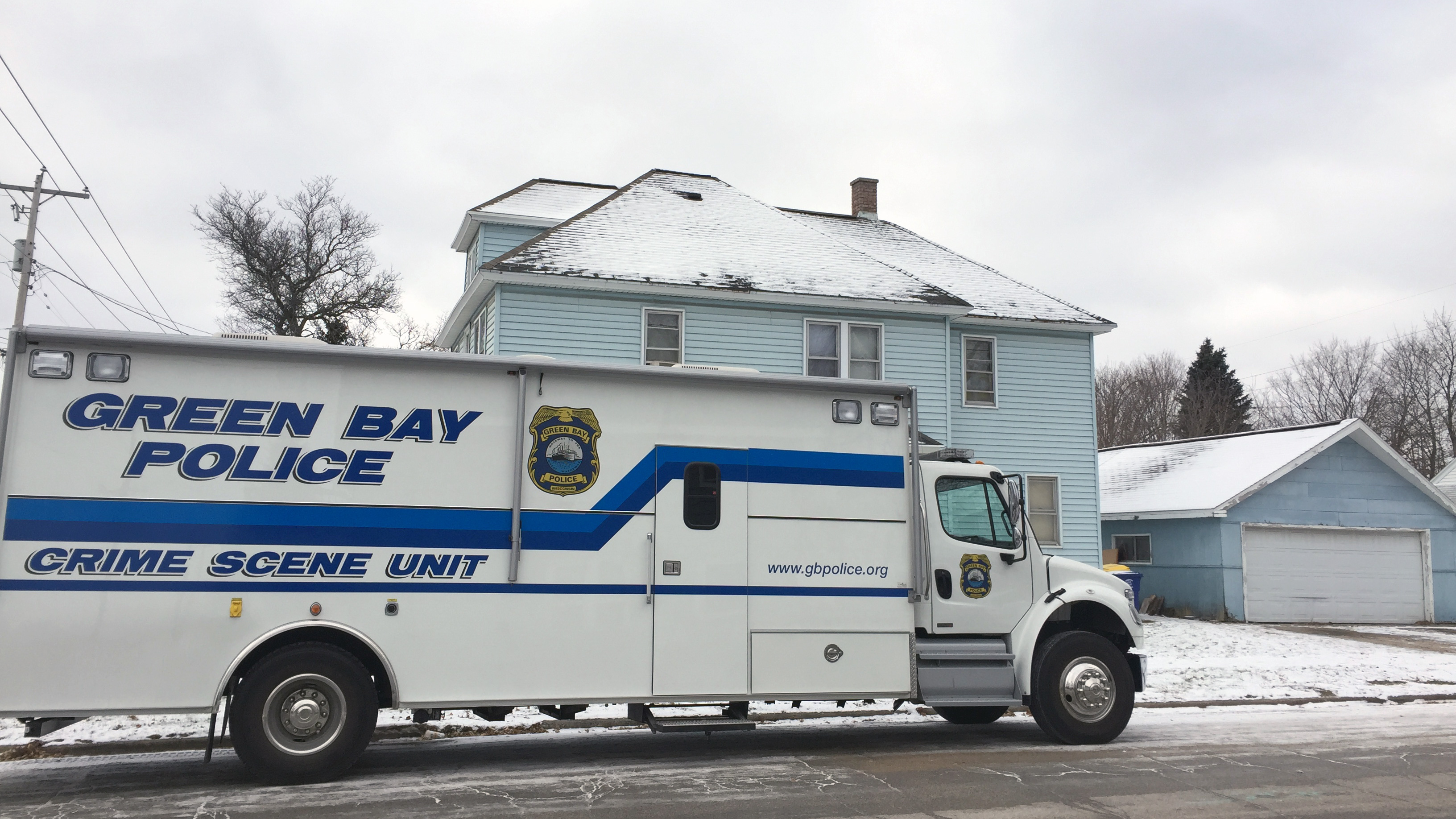 Green Bay police investigate the death of a 26-year-old man in the 1000 block of Reber St. Dec. 12, 2017. (WLUK/David Duchan)