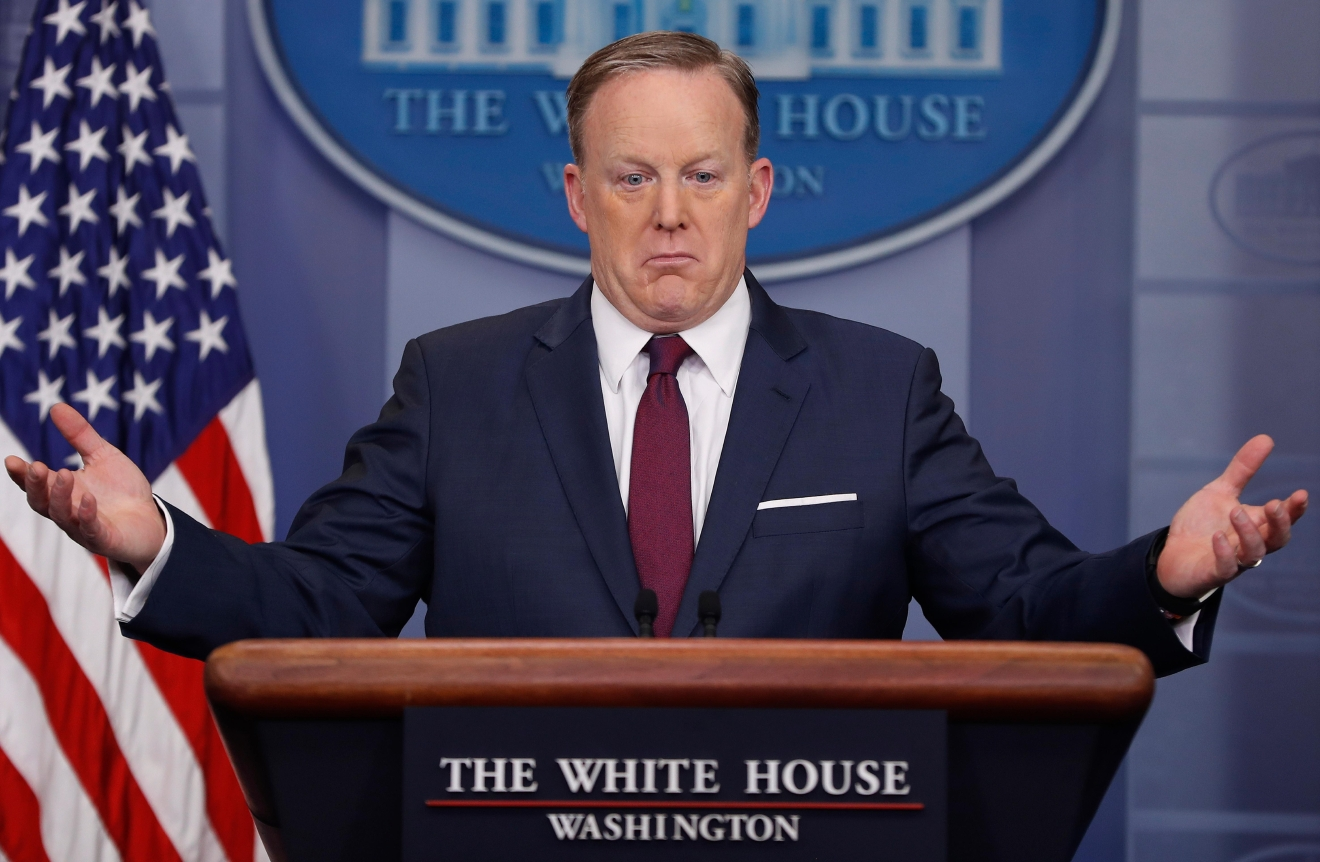 White House press secretary Sean Spicer gestures while speaking to the media during the daily briefing in the Brady Press Briefing Room of the White House in Washington, Friday, March 24, 2017. (AP Photo/Pablo Martinez Monsivais)