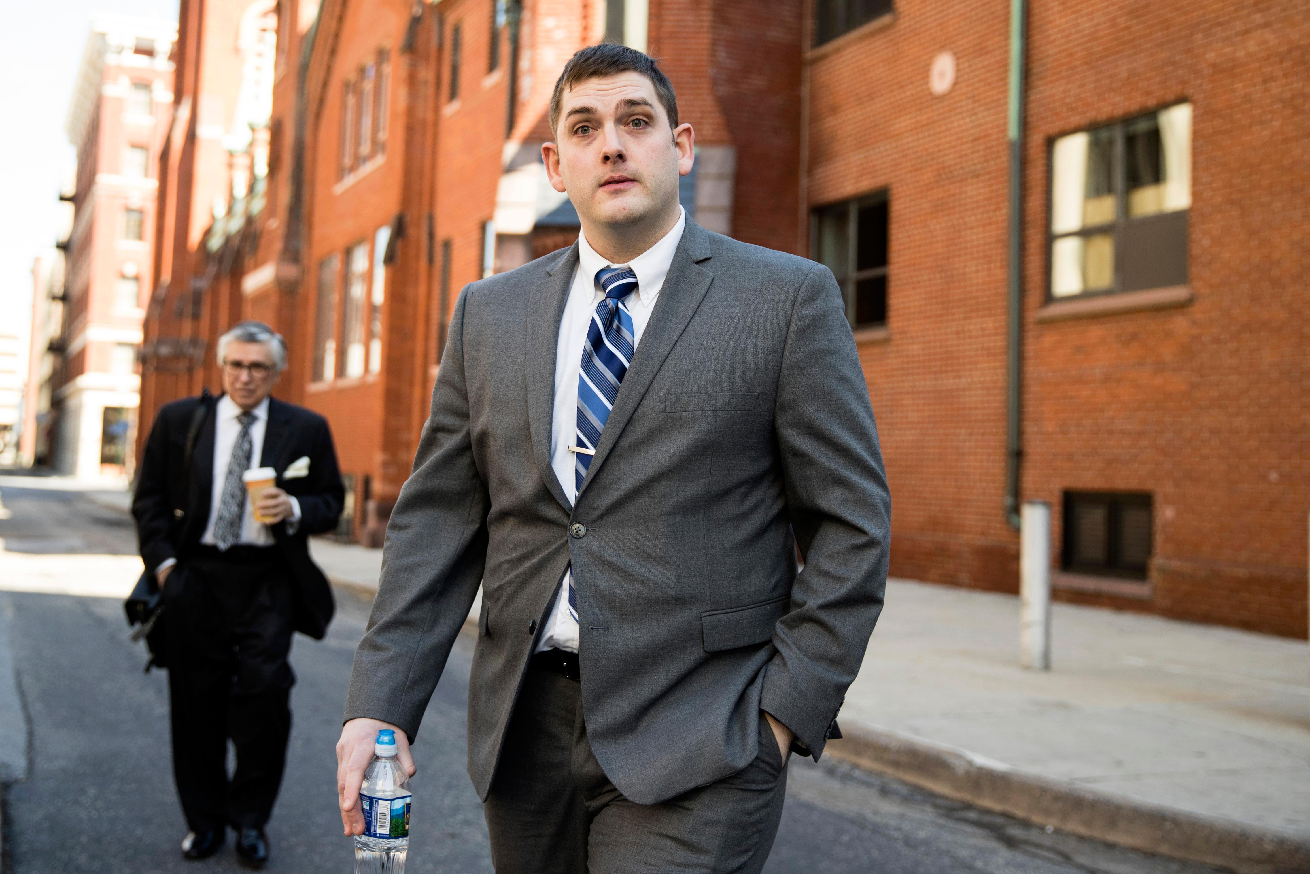 In this March 12, 2019 file photo, former East Pittsburgh police officer Michael Rosfeld, charged with homicide in the shooting death of Antwon Rose II, walks to the Dauphin County Courthouse in Harrisburg, Pa.{ } (AP Photo/Matt Rourke)