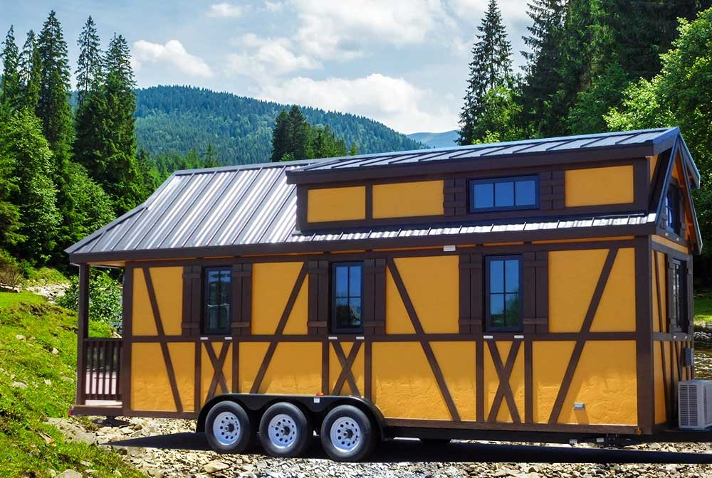 "If you've ever wanted to experience staying in a tiny house, now is the time! A new tiny house retreat exists at Thousand Trails Leavenworth RV Campground. ""Petite Retreats"" is a Tiny House Village in Leavenworth, WA and is surrounded by seven miles of hiking trails, near forests and meadows and right by Alpine Trout Lake and Otter Pond. Each tiny home has a Bavarian theme and are named, ""Adeline,"" ""Belle,"" ""Hanna,"" ""Otto"" and ""Rudolf.""{ } Amenities include a swimming pool, playground, lakes, hiking trails, and more. Info at petiteretreats.com (Image courtesy of Petite Retreats)"