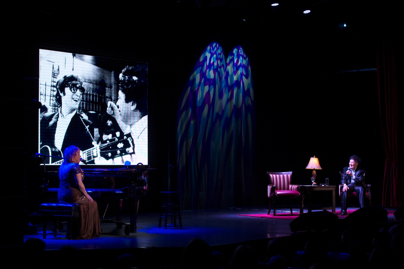 Comedian Marty Allen and his wife Karon Kate Blackwell celebrate his 95th birthday with a show at the South Point Thursday, March 23, 2017. Projected on the screen is a photo of Allen and John Lennon when they appeared on the Ed Sullivan Show. [Sam Morris/Las Vegas News Bureau]