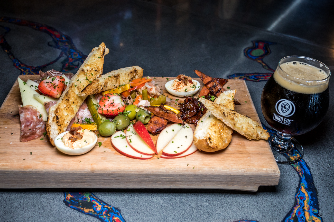Brew Master Board: prosciutto, soppressata, grilled Andouille, manchego, goat cheese, pimento cheese, bacon jam, deviled egg, pickled veg, Castelvetrano olives, bread, and crackers / Image: Catherine Viox // Published: 9.12.20
