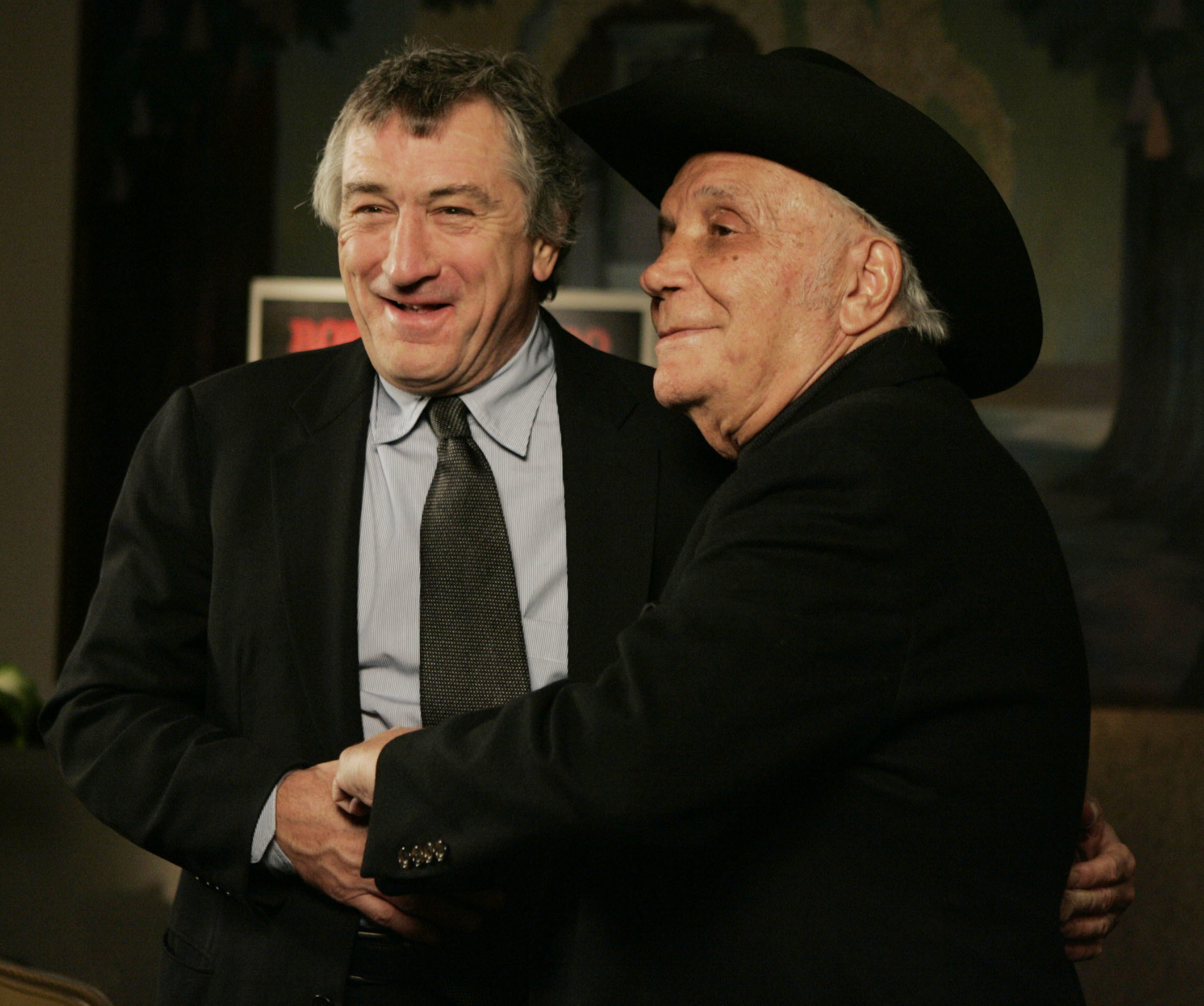 "FILE - In this Jan. 27, 2005, file photo, Robert DeNiro, left, and boxer Jake LaMotta stand for photographers before watching a 25th anniversary screening of the movie ""Raging Bull"" in New York. LaMotta, whose life was depicted in the film ""Raging Bull,"" died Tuesday, Sept. 19, 2017, at a Miami-area hospital from complications of pneumonia. He was 95.  (AP Photo/Julie Jacobson, File)"