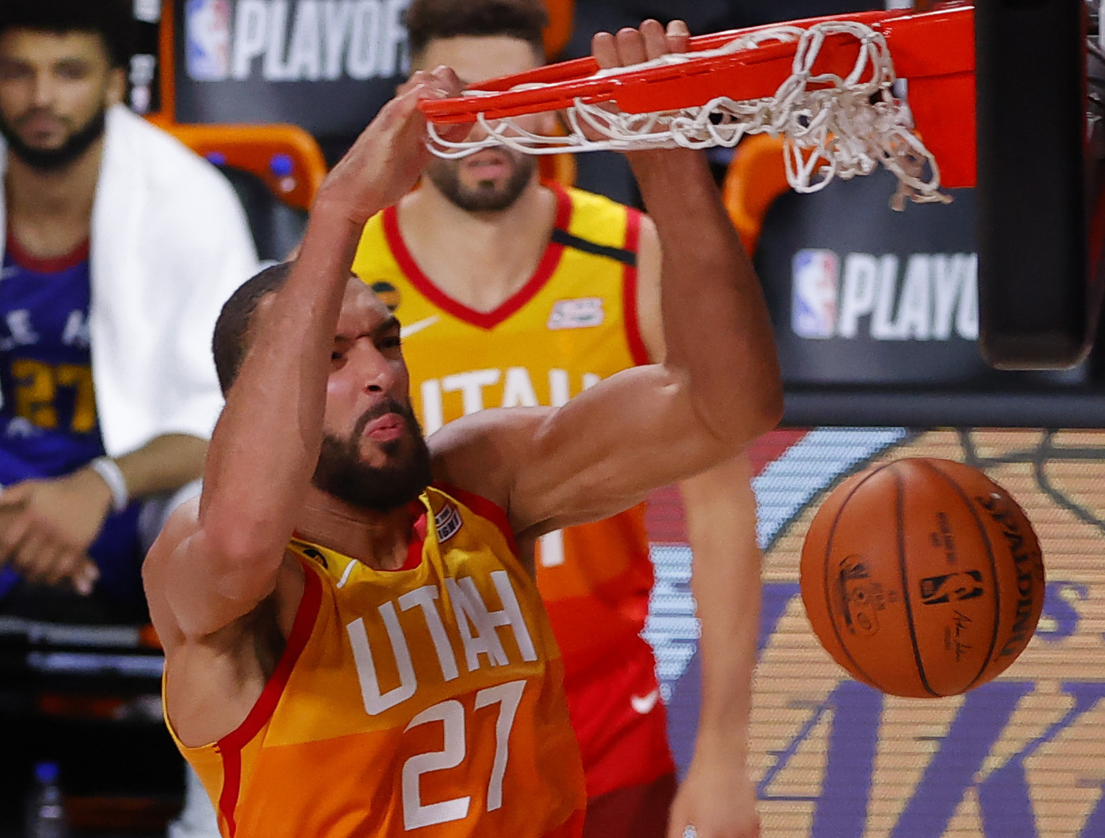 Utah Jazz's Rudy Gobert dunks against the Denver Nuggets during the third quarter in Game 4 of an NBA basketball first-round playoff series, Sunday, Aug. 23, 2020, in Lake Buena Vista, Fla. (Kevin C. Cox/Pool Photo via AP)