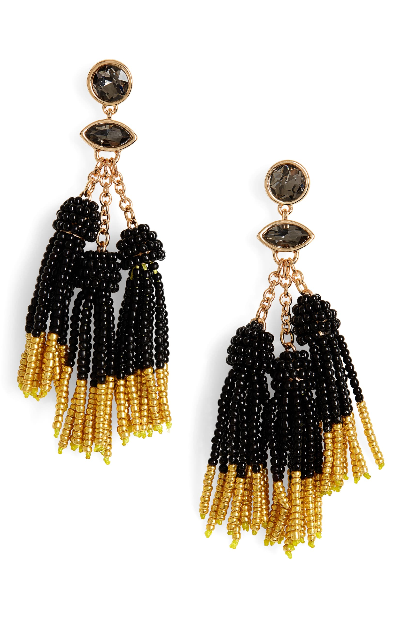 Turn a simple outfit into a statement-making one by putting on these swishy beaded-tassel earrings. Shop it{ }- $35. (Image: Nordstrom){ }