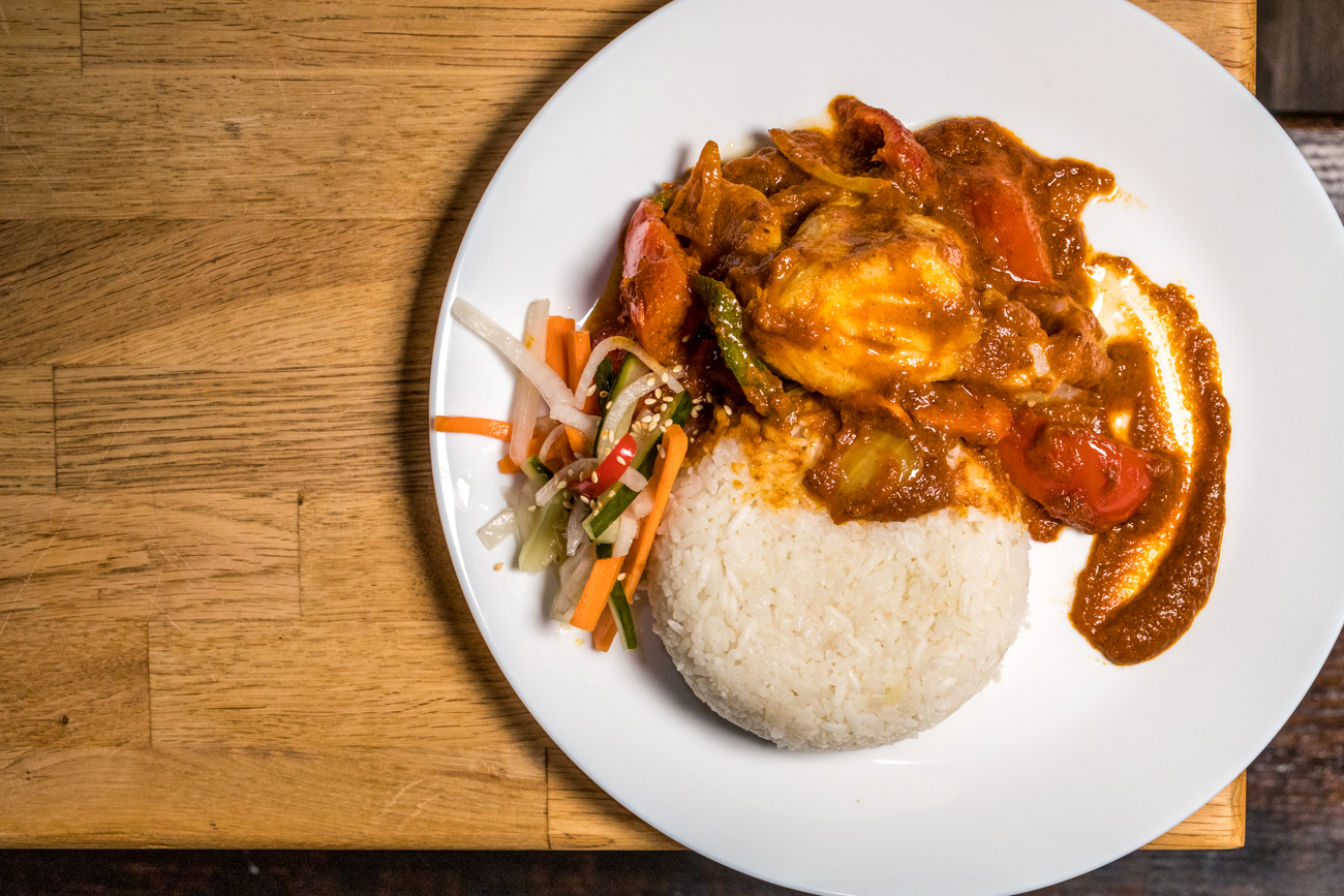 Asam fish with tomato, onion and bell peppers in a tamarind sauce / Image: Catherine Viox // Published: 1.15.20