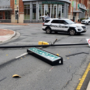 Wind takes down traffic light pole in Alexandria