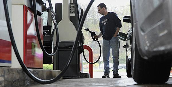 FILE- In this April 28, 2011 file photo, John Magel pumps gas at a station in Wethersfield, Conn. Consumers paid more for gas and food in April, lifting inflation to its highest level in two and a half years. But inflationary pressures have begun to ease in May 2011, and analysts say some prices could taper off by summer. (AP Photo/Jessica Hill, file) - AP