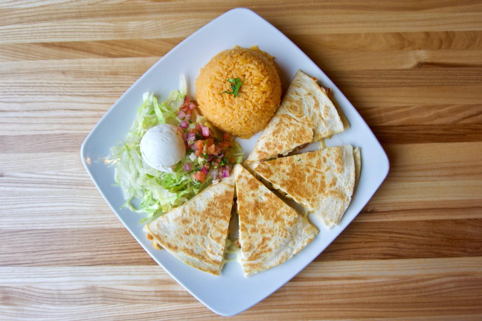 <p>Supreme chicken quesadilla: stuffed with onion, peppers, mushrooms, tomato, and zucchini, served with rice, beans, lettuce, pico de gallo, and sour cream / Image: Brian Planalp // Published: 1.29.18</p>