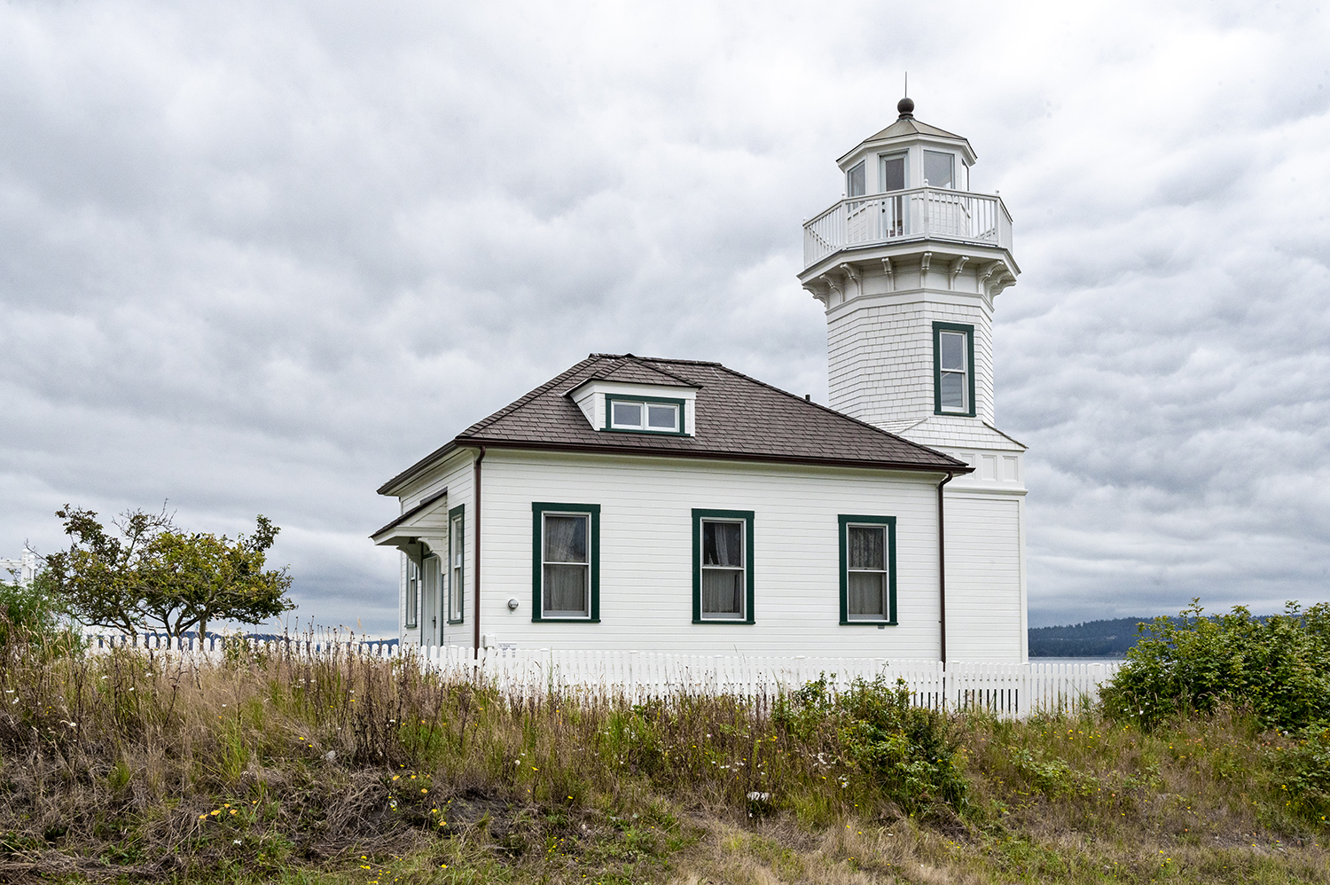 At first glance, Dimick Lighthouse in Port Townsend looks a lot like the 1906 Mukilteo Light Station — and that's because it was specifically designed that way. But don't be fooled, this isn't a lighthouse at all, it's a frequently-photographed, private residence. (Image: Rachael Jones / Seattle Refined)