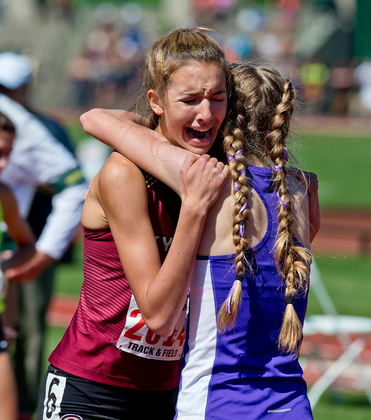 Competitors congratulate each other after a race at the OSAA Championship at Hayward Field on Saturday. Photo by Dan Morrison, Oregon News Lab