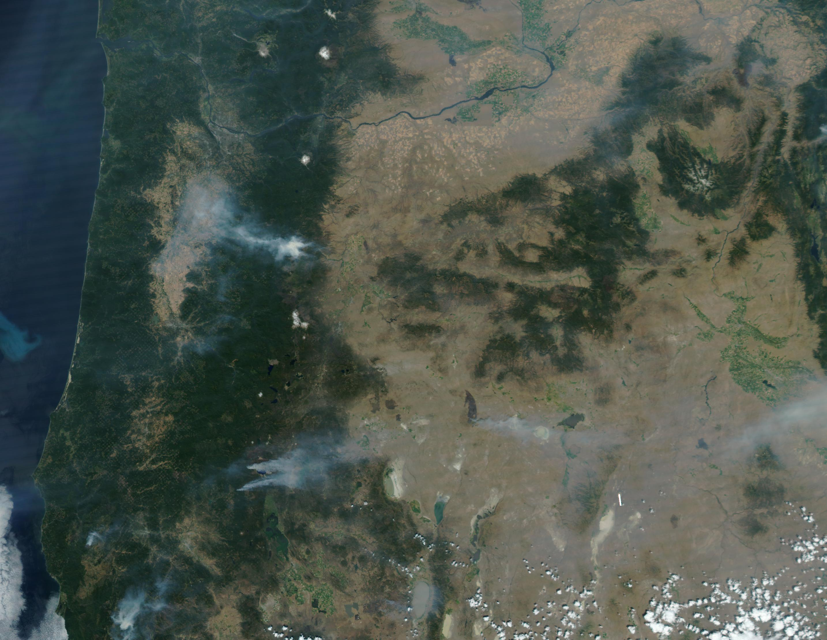 NASA satellite image from August 3 shows the Blanket and Spruce Lake Fires burning near Crater Lake National Park.