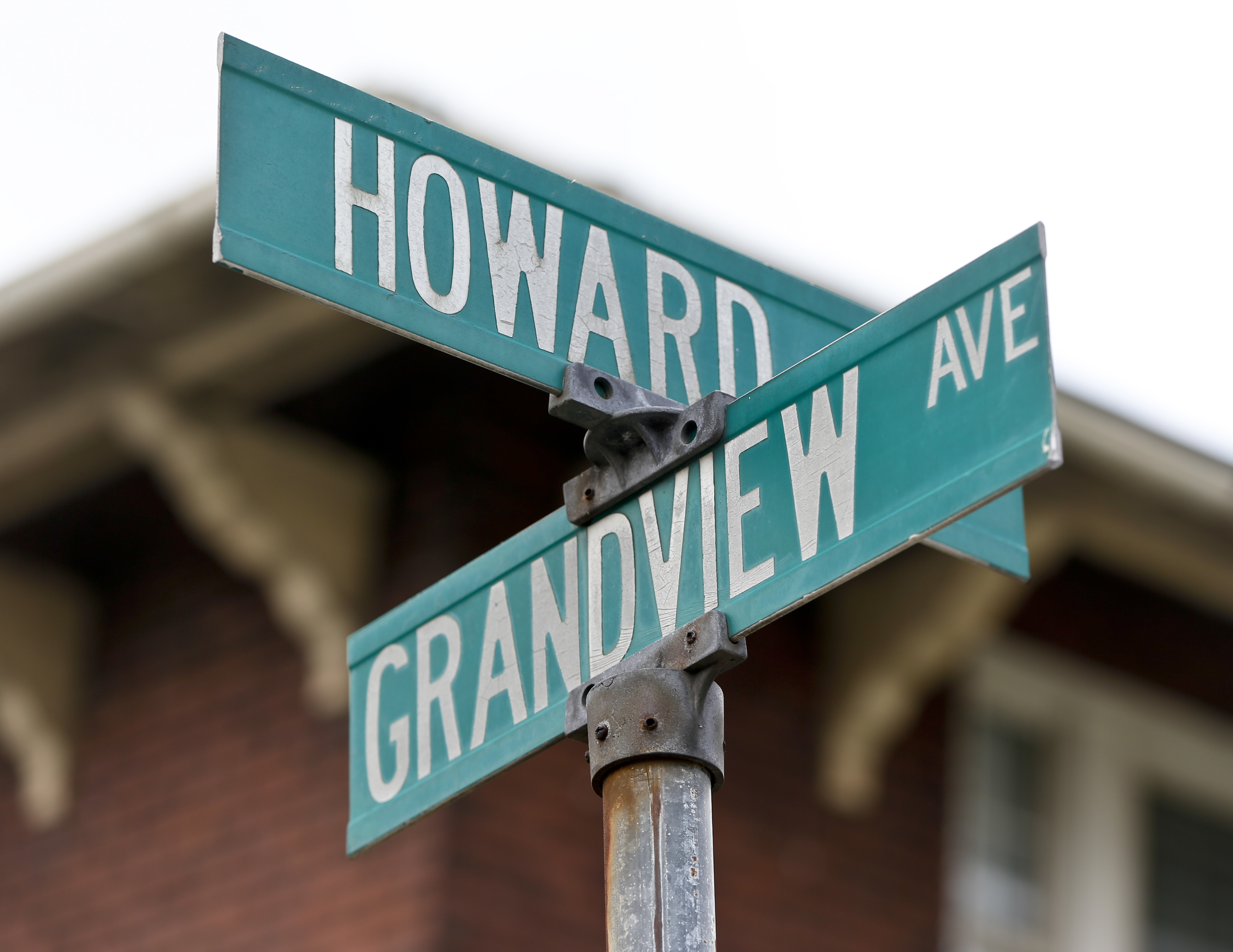 Street signs mark the intersection of Howard and Grandview Ave. on Wednesday, June 20, 2018, near where witnesses say a police officer fatally shot a 17-year-old boy just seconds after he fled from a traffic stop in a confrontation late Tuesday, in East Pittsburgh, Pa. (AP Photo/Keith Srakocic)