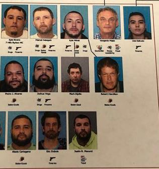 "Nearly 50 people in connection to what authorities believe is the single largest ""takedown"" in Rhode Island history were arrested in connection to drug raids. (Police photo)"