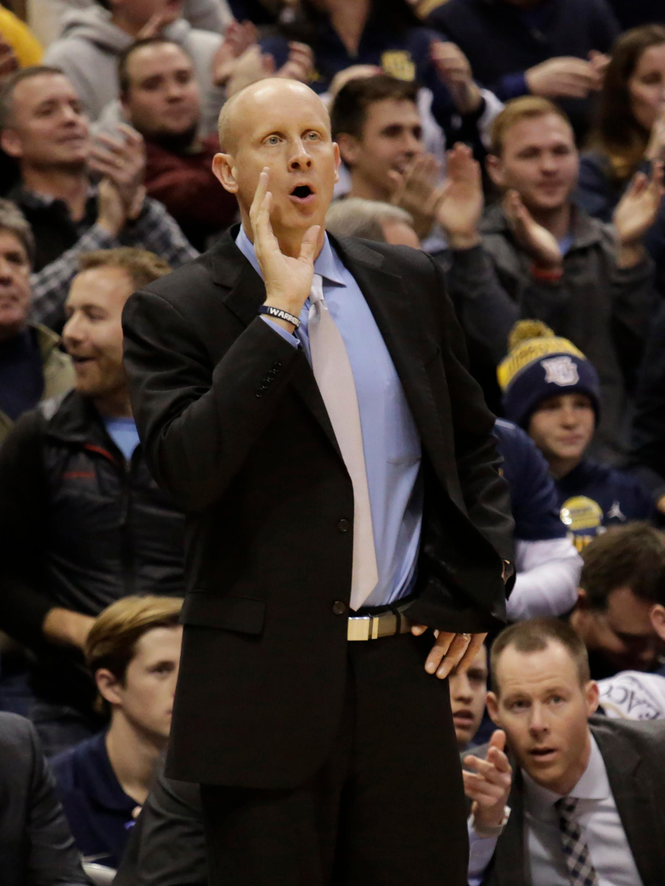 Xavier head coach Chris Mack calls out his players as they take on Marquette during the first half of a basketball game, Wednesday, Dec. 27, 2017, in Milwaukee. (AP Photo/Darren Hauck)