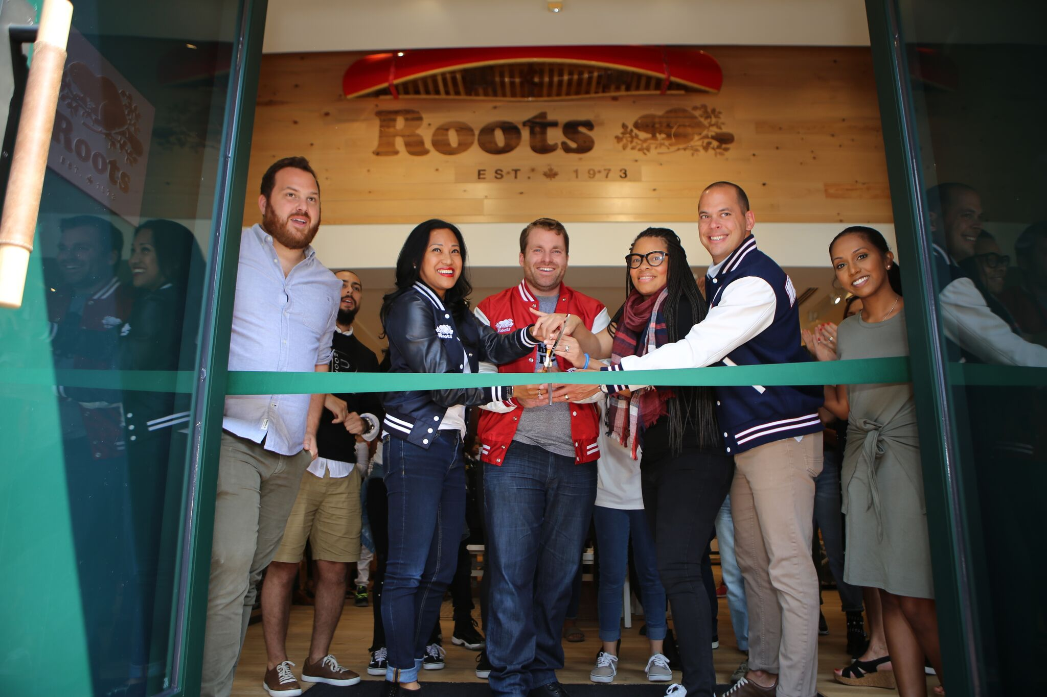 Almira Cuizon, Sean Ball, Freda Fanning and Alex Jones from Roots opened the Georgetown Roots store with a ribbon-cutting ceremony.{&amp;nbsp;} (Image: Courtesy Roots)<p></p>