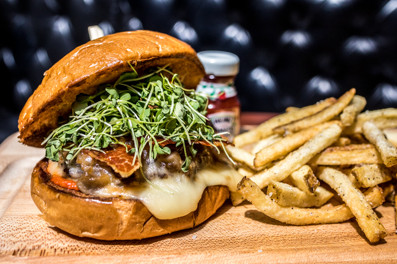 Subito Burger: Piedmontese ground beef, Taleggio cheese, grilled prosciutto, caramelized onion, arugula, tomato aioli, and hand-cut fries / Image: Catherine Viox{ }// Published: 6.22.20