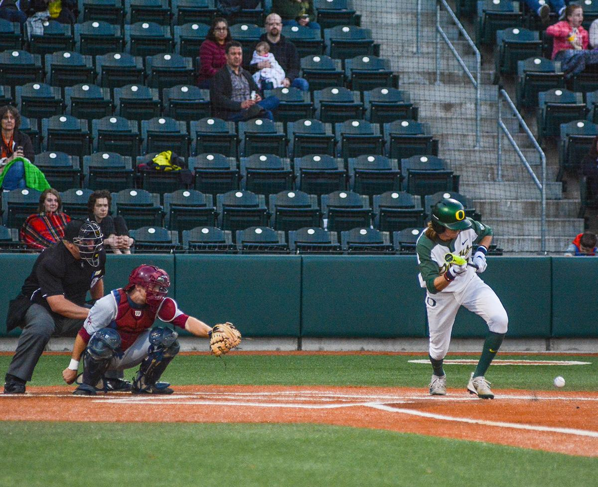 Ducks Mathew Dyer (#7) attempts to reach base by bunting the ball. On Wednesday night the Ducks fell to the Loyola Marymount Lions 4-0 at PK Park. Photo by Jacob Smith, Oregon News Lab