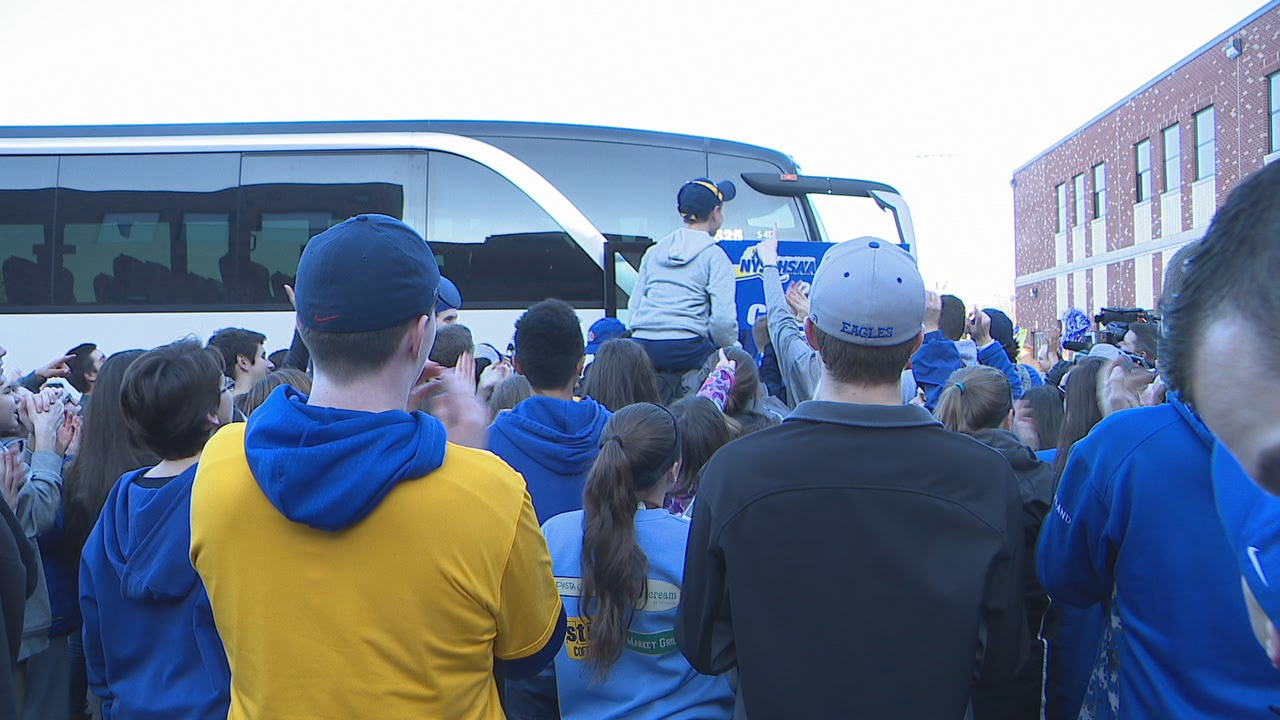 The Irondequoit Eagles get mobbed by fans as they return home from their state title victory in Binghamton.