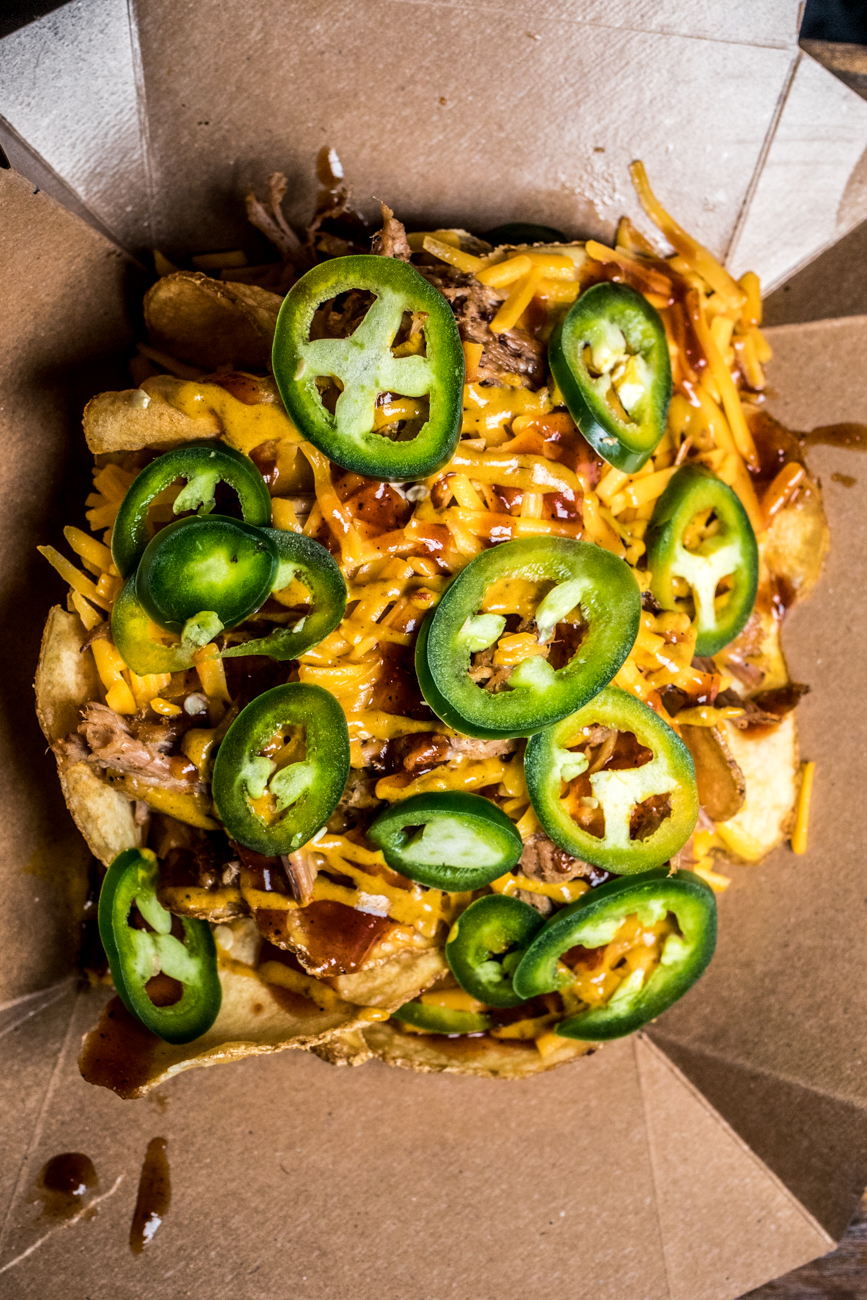 Shack Stack: saratoga chips topped with choice of chicken or pork, cheddar cheese, jalapeños, Carolina mustard, and Sweet 'n Smokey sauce / Image: Catherine Viox{ }// Published: 4.13.20