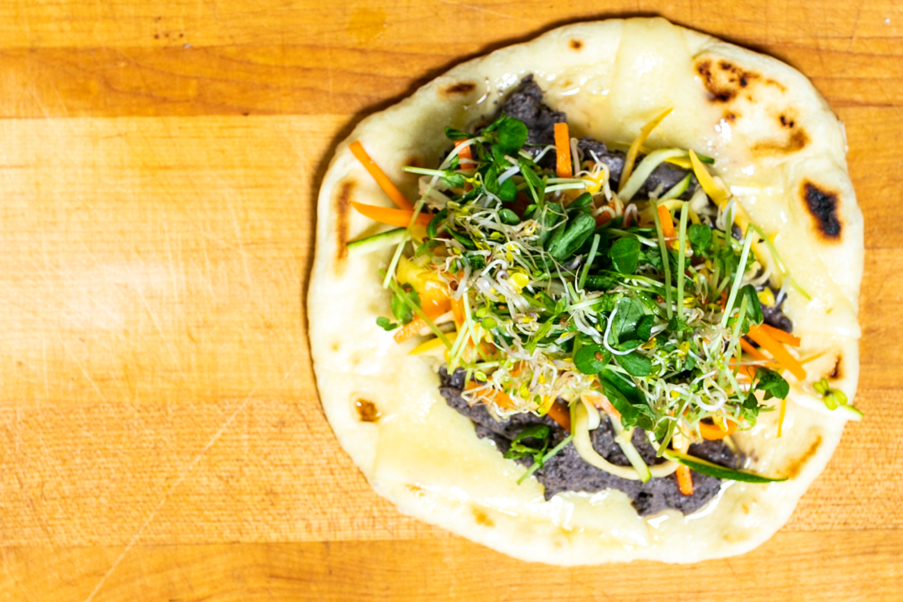 Pita Piper: Spicy black bean hummus, Havarti cheese, julienne veggies, and sprouts on a fresh pita{ }/ Image: Amy Elisabeth Spasoff // Published: 9.29.18
