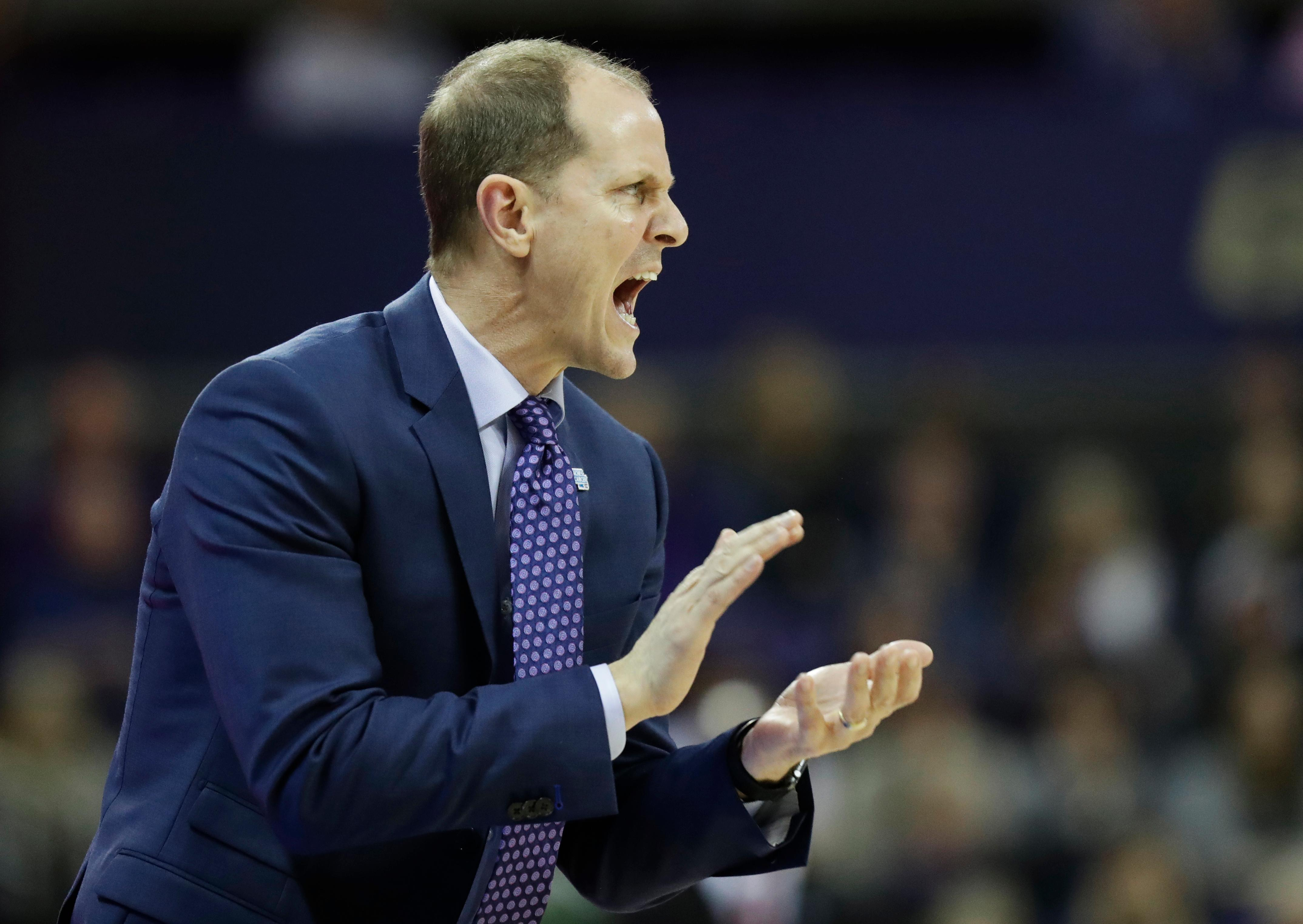 In this Sunday, Jan. 28, 2018 photo, Washington head coach Mike Hopkins calls to his team during the first half of an NCAA college basketball game against Washington State in Seattle. One of the most surprising stories in college basketball is what Hopkins is doing in his first season at Washington and how the Huskies are in the conversation for an NCAA bid entering February. (AP Photo/Ted S. Warren)