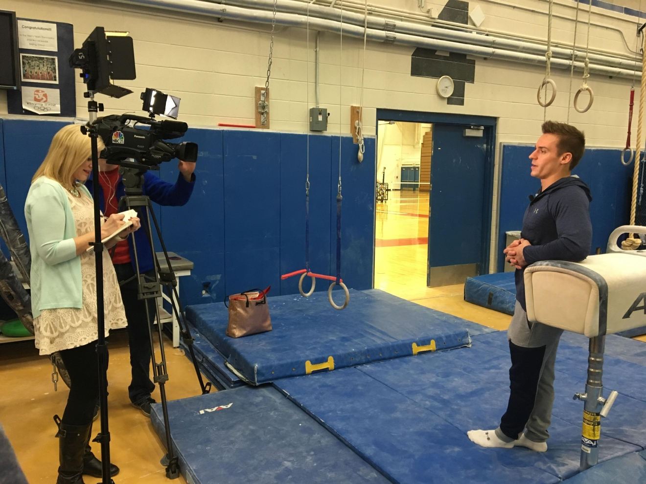 NBC 25 Anchor, Sadie Hughes, at the Olympic Training Center in Colorado Springs, Colorado, interviewing Team USA gymnast, Sam Mikulak. Photo Credit: Michael Horne.