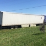 2 men killed, woman hurt after semitrailer hits 6 vehicles