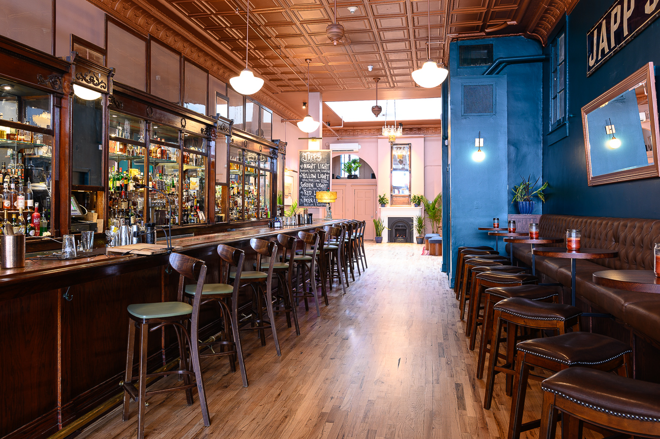 Japps' three-month remodel brightened its color palette, refurbished its furniture and floors, added a variety of new seating, and increased the overall comfortability of the bar. Molly Wellman, award-winning bartender and owner of Japp's, wanted a fresh look without totally erasing Japp's established personality. The result is a place where regulars will still recognize their local watering hole while improving the general look of the bar. The ever-changing cocktail menu, live music, and entertainment people have grown to love at Japp's remain. ADDRESS:{&nbsp;}1136 Main Street (45202) / Image: Phil Armstrong, Cincinnati Refined // Published: 10.25.19<p></p>
