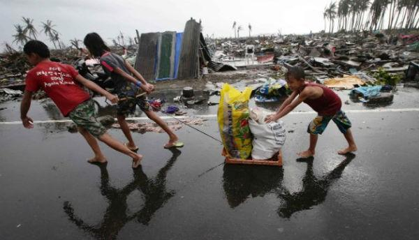 Residents transport relief goods in Tacloban.