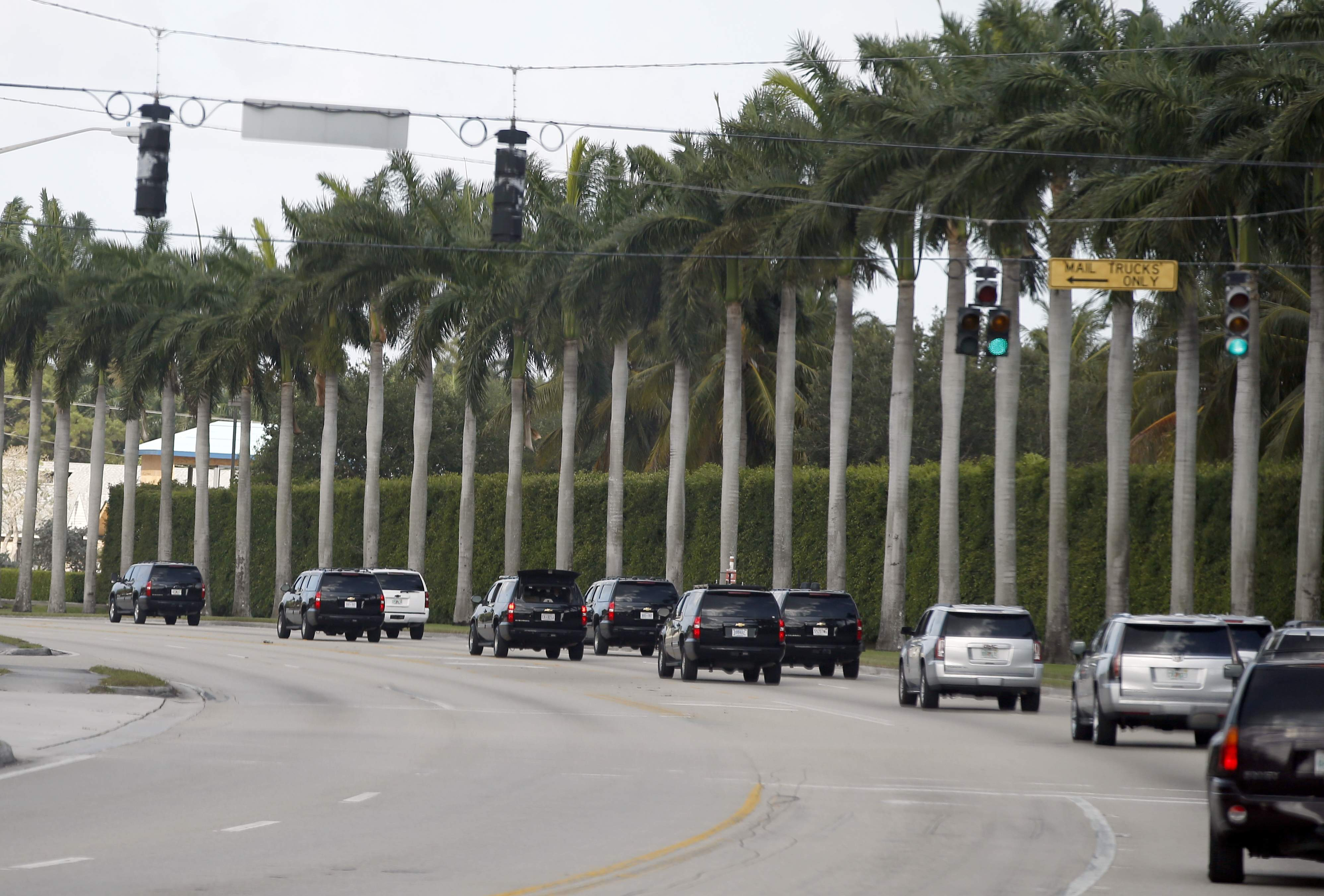 DAY 86 - In this April 15, 2017, file photo, the motorcade for President Donald Trump heads to the Trump International Golf Club in West Palm Beach, Fla. The president was in Florida with his family on day 86 and had no media events and was not photographed. (AP Photo/Alex Brandon, File)