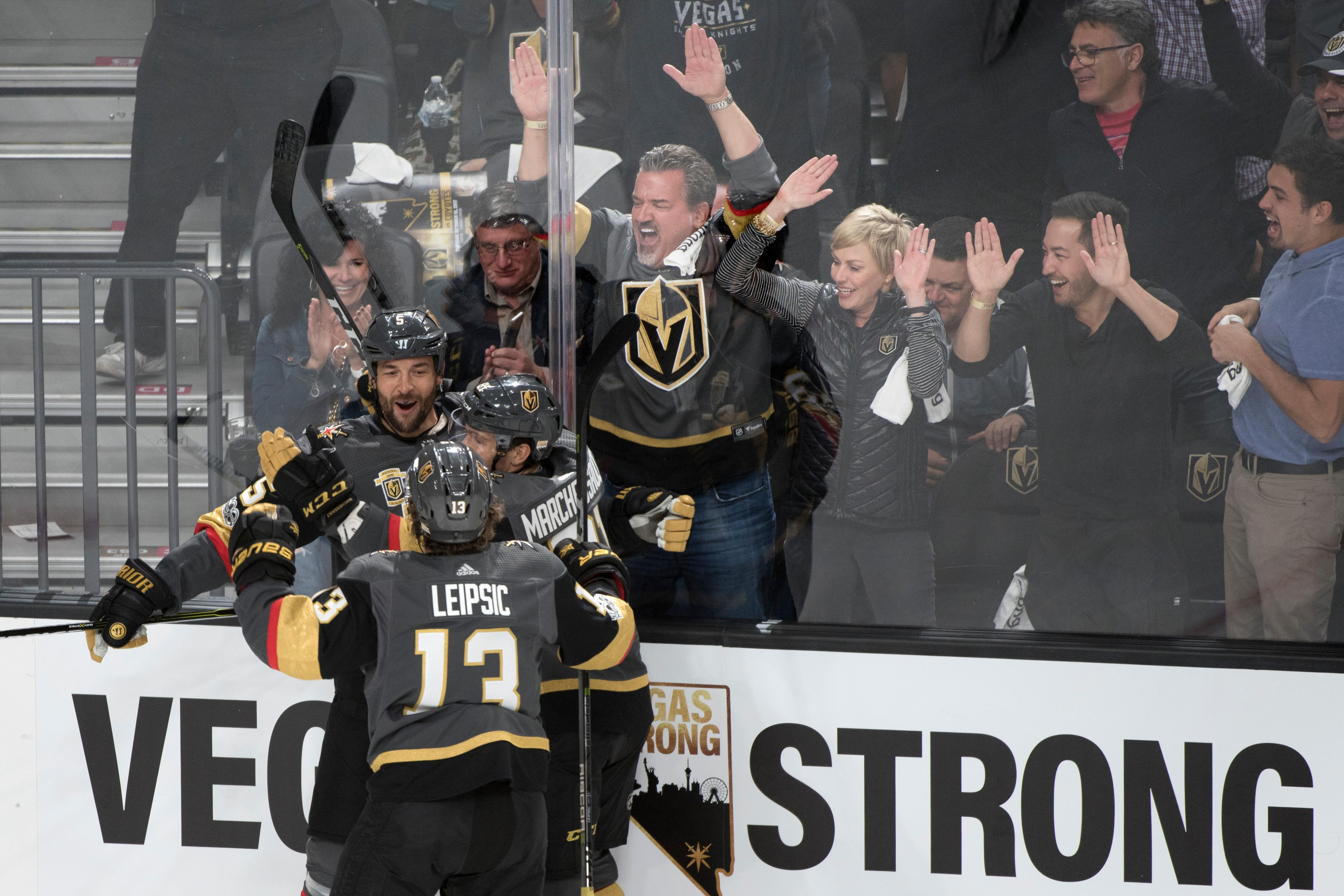 Vegas Golden Knights defenseman Deryk Engelland (5), Vegas Golden Knights right wing Brendan Leipsic (13) and Vegas Golden Knights left wing Jonathan Marchessault (81) celebrate Engelland's goal against the Arizona Coyotes during the Knights home opener Tuesday, Oct. 10, 2017, at the T-Mobile Arena. The Knights won 5-2 to extend their winning streak to 3-0. CREDIT: Sam Morris/Las Vegas News Bureau