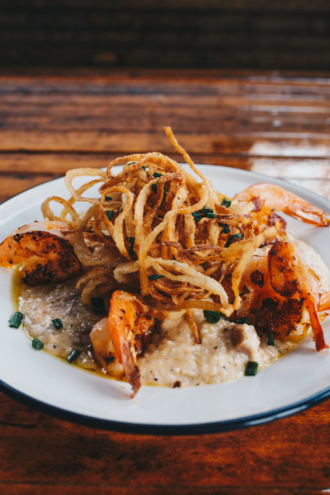 Shrimp & grits : Tasso grits topped with blackened shrimp, fried onion straws, and chives / Image: Catherine Viox // Published: 3.24.19