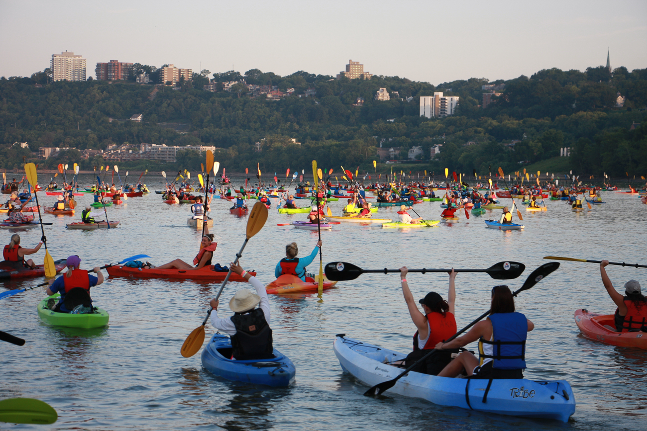 Thousands raise their paddles on the Ohio River during this year's Paddlefest. / Image: Dr. Richard Sanders