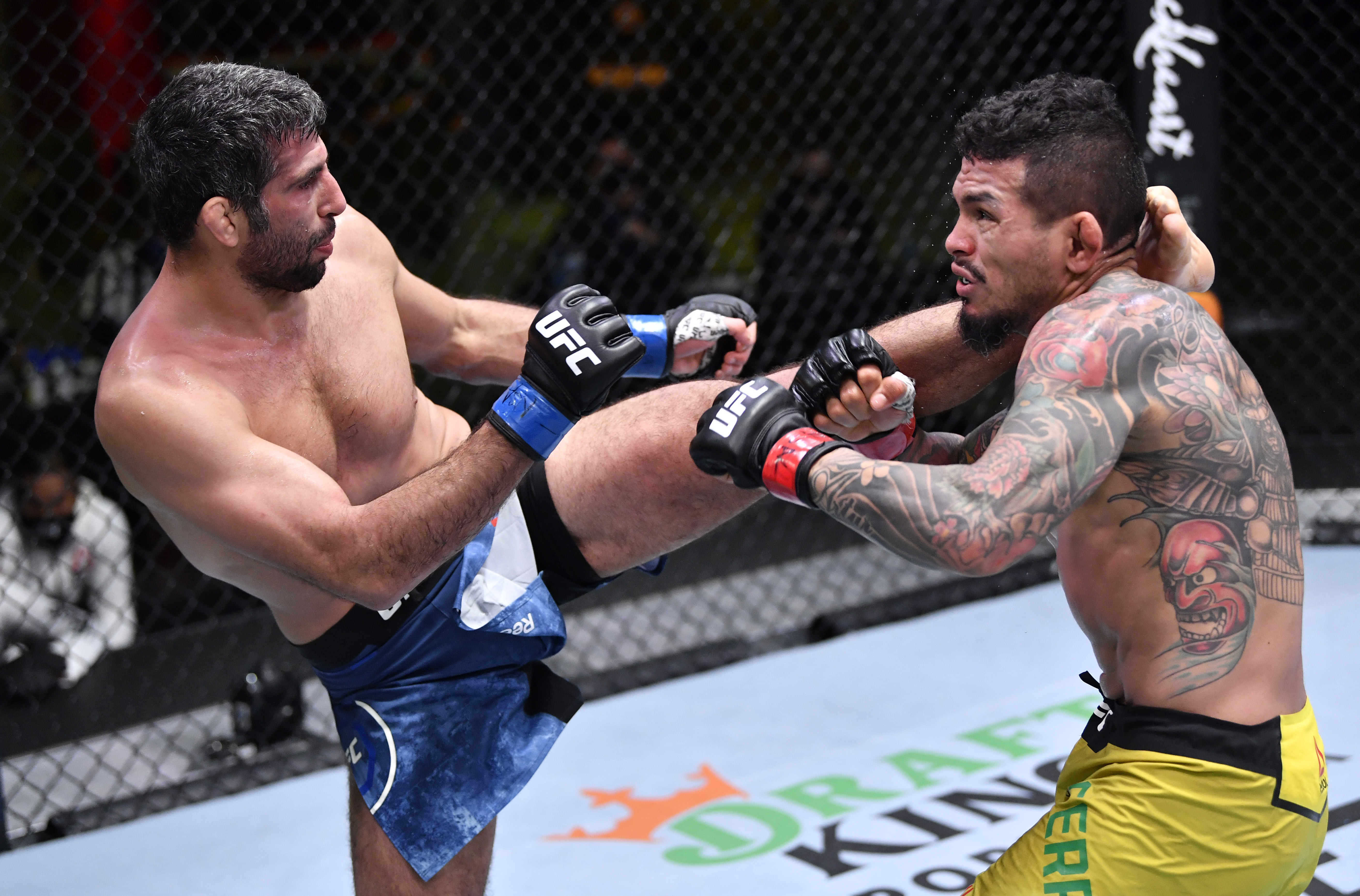 LAS VEGAS, NEVADA - FEBRUARY 06: In this handout image provided by UFC, (L-R) Beneil Dariush of Iran kicks Diego Ferreira of Brazil in their lightweight fight during the UFC Fight Night event at UFC APEX on February 06, 2021 in Las Vegas, Nevada. (Photo by Chris Unger/Zuffa LLC via Getty Images)