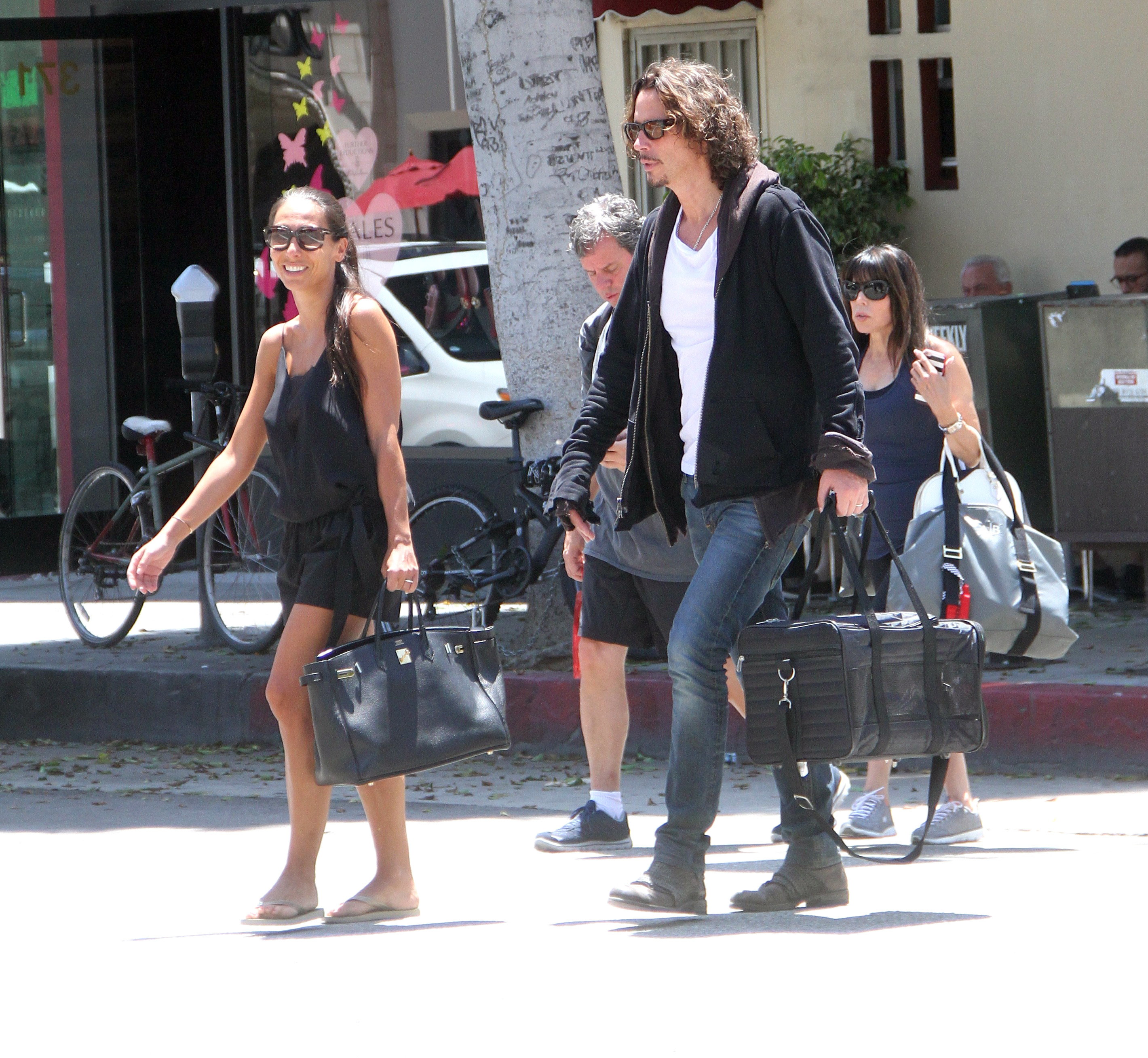 Soundgarden frontman Chris Cornell goes shopping in Beverly Hills with his wife  Featuring: Chris Cornell, Vicky Karayiannis Where: Los Angeles, California, United States When: 30 Jul 2015 Credit: WENN.com