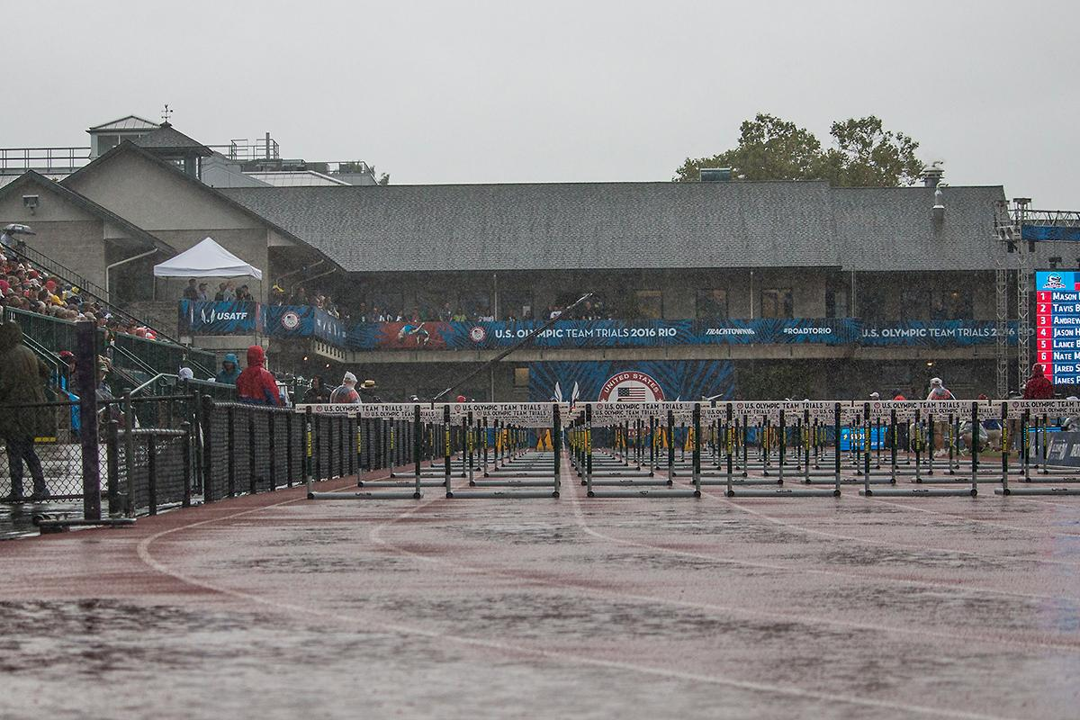 Hurdles are prepared for competition as Hayward Field and its audience experience a downpour of rain. Day Eight of the U.S. Olympic Trials Track and Field continued on Friday at Hayward Field in Eugene, Ore. and will continue through July 10. Photo by Katie Pietzold