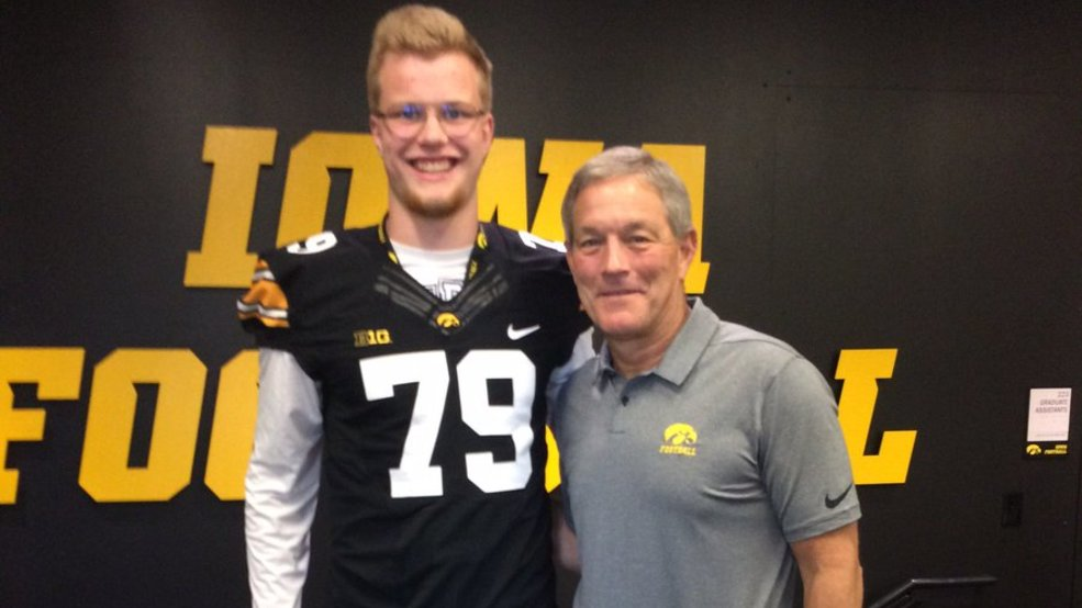 Bay Port's Jack Plumb stands with Iowa coach Kirk Ferentz during a recent visit to Iowa.