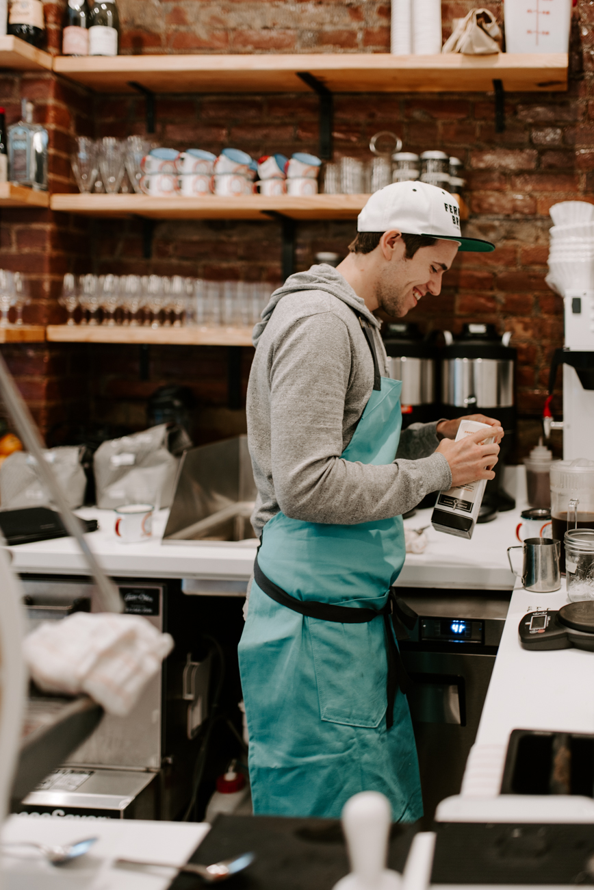 Austin Ferarri behind the coffee bar / Image: Brianna Long // Published: 6.10.19