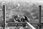 Workers_on_outer_ring_of_Space_Needle_ca_late_January_1962.jpg