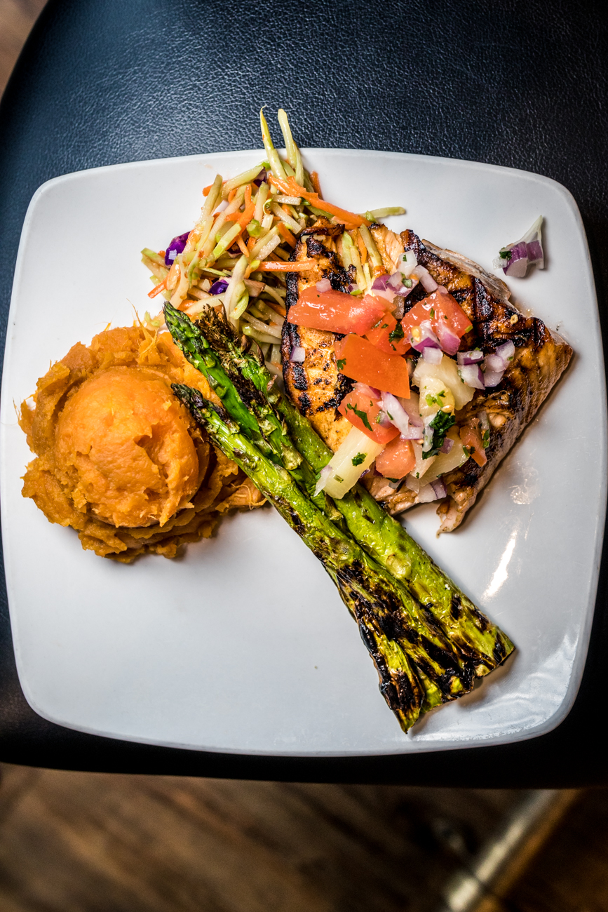 Kingston Salmon: mango habanero-rubbed salmon grilled and topped with pineapple salsa and served with sweet chili slaw, asparagus, and mashed sweet potatoes / Image: Catherine Viox{ }// Published: 3.7.20